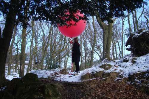 Edwina Fitzpatrick with a video camera attached to a 1.7 metre helium filled balloon part of a year long experiment involving videoing forest thresholds working with the Forestry Commission in Grizedale Forest, one of several organisations working to strengthen the visual arts through CVAN North West.