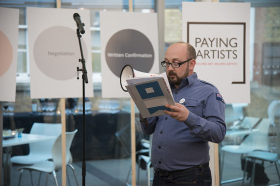 Dan Thompson's performance in support of his Paying Artists Artist-led Manifesto at the launch of  Exhibition Payment: The a-n/AIR Paying Artists Guide  on Wednesday 12 October. Photo: Kirstin Sinclair.