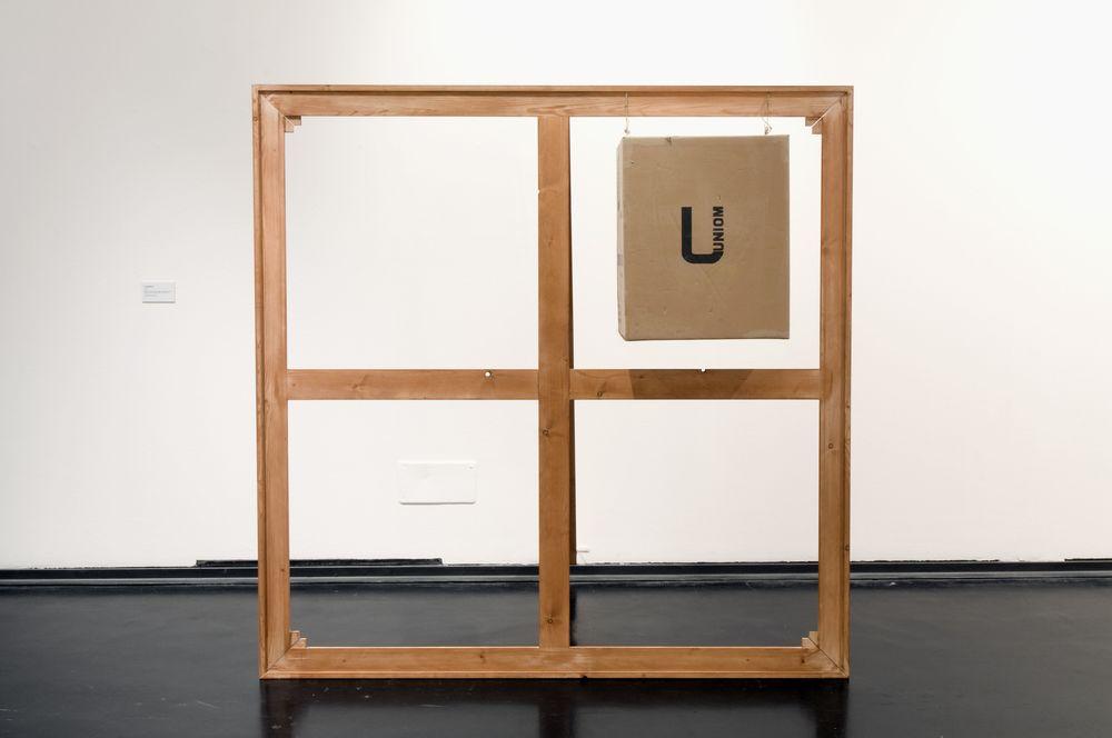 La Scatola U, 1966,telaio, asta di sostegno in legno, scatola di cartone, cm 190 x 190 x 100  La Scatola U, 1966,casement, wooden supporting post, carton box, cm 190 x 190 x 100