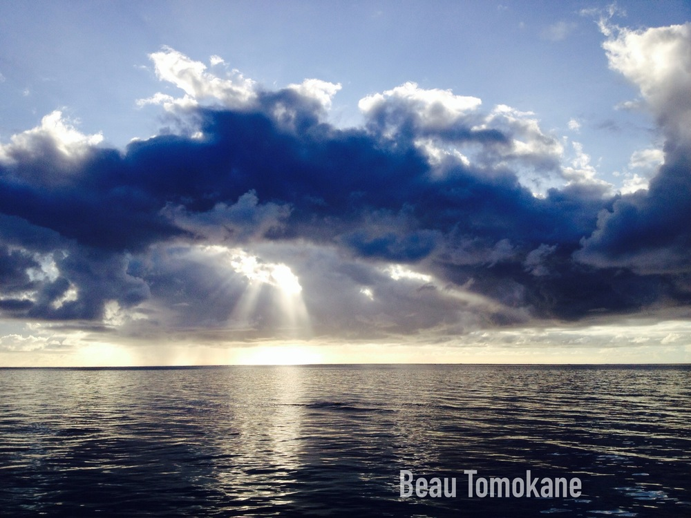 This is a beautiful picture of a sunset's beams coming through clouds and onto the ocean in one of Saipan's beaches. The photography is by our brother Beau Tomokane. He took it sometime later the day Mom died.