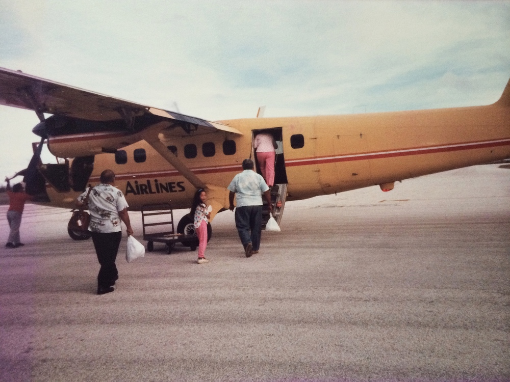 Mom taking me along to fly with her during one of her business trips to the island of Tinian or Rota