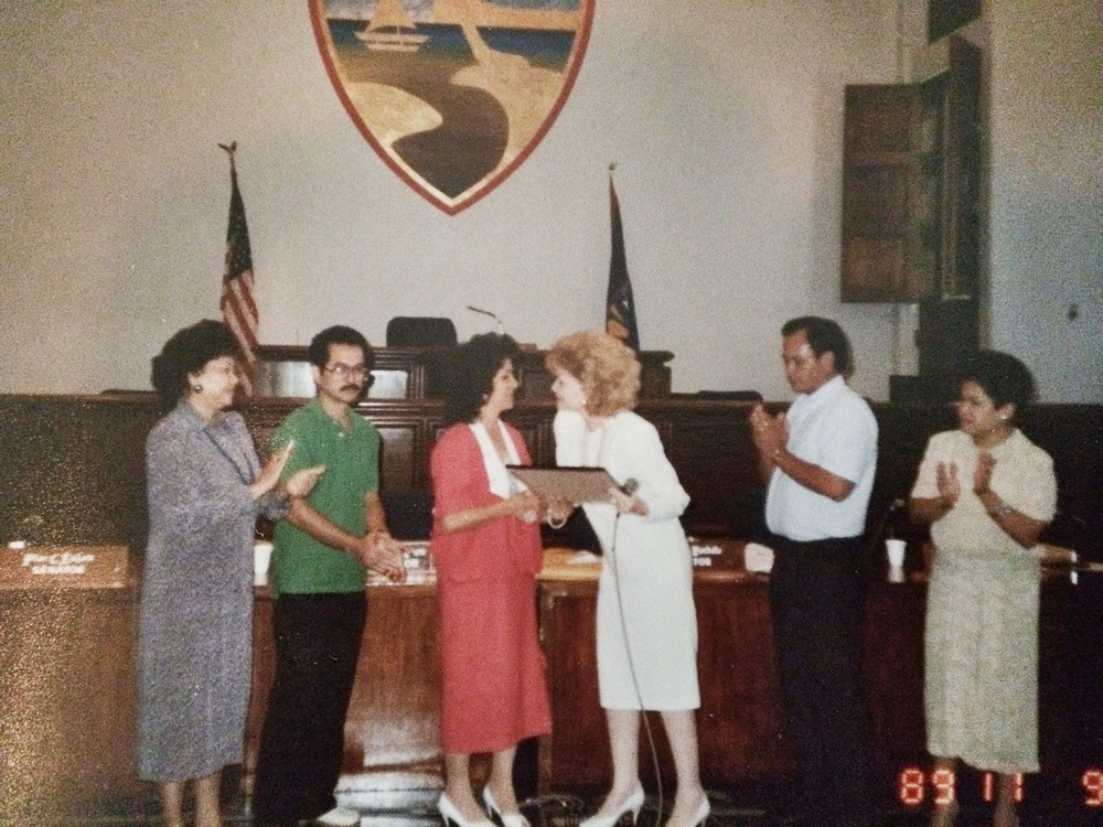 Guam 1989. Dad is standing beside Mom as she receives her plaque from then First Lady Madeleine Bordallo (now Congresswoman) of Guam