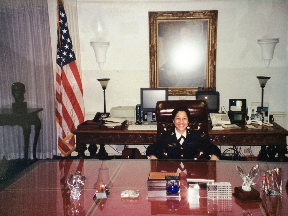 Sitting at the Secretary of Defense's desk at the Pentagon