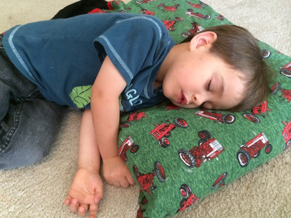 Daniel (3) sleeps on his pillow during our Quiet Time after lunch