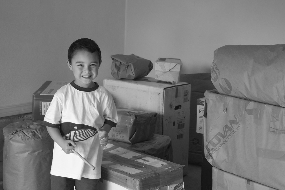 2012  - Abraham (4) is excited about unpacking more of our shipment from our overseas move!