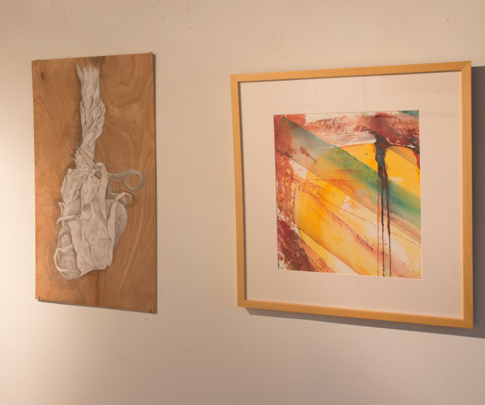 "Barbara Spaulding Stephenson ,  Rock, Paper, Scissors,  silverpoin t,  24""x13"" (left) and Elaine Viel  The Nakba Sun  , watercolor (right)"