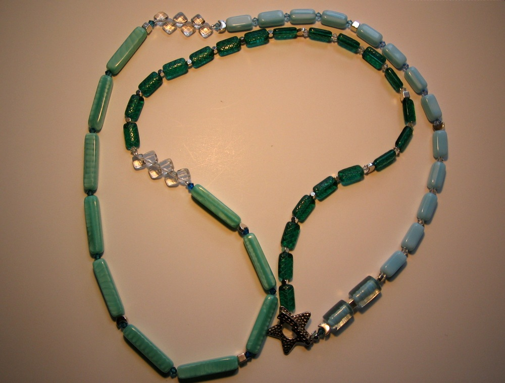 One of the first necklaces I made (and photographed), 2008.  Too dark and a weird background color, right?