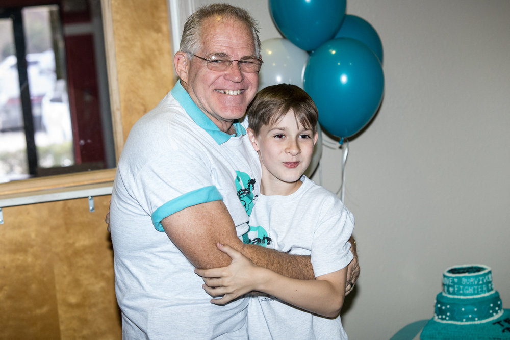 IF YOU DON'T KNOW OUR FAMILY, YOU WON'T EVEN BELIEVE WHO THIS IS! THIS IS MY DAD & OUR SON, AT MY MOM'S SURVIVOR PARTY!  SO MY PARENTS GOT DIVORCED WHEN I WAS A TEEN AND BOTH REMARRIED & MY 4 PARENTS HAVE THE MOST BEAUTIFUL RELATIONSHIP YOU CAN EVER IMAGINE! IT HAS INVOLVED FORGIVENESS, GRACE, SACRIFICE AND LOVE...TRULY MIRACULOUS! MY MOM & DAD'S WIFE CALL EACH OTHER WIFE-IN-LAWS. SO SWEET. GOD HAS USED THIS JOURNEY TO JUST DRAW US ALL CLOSER!