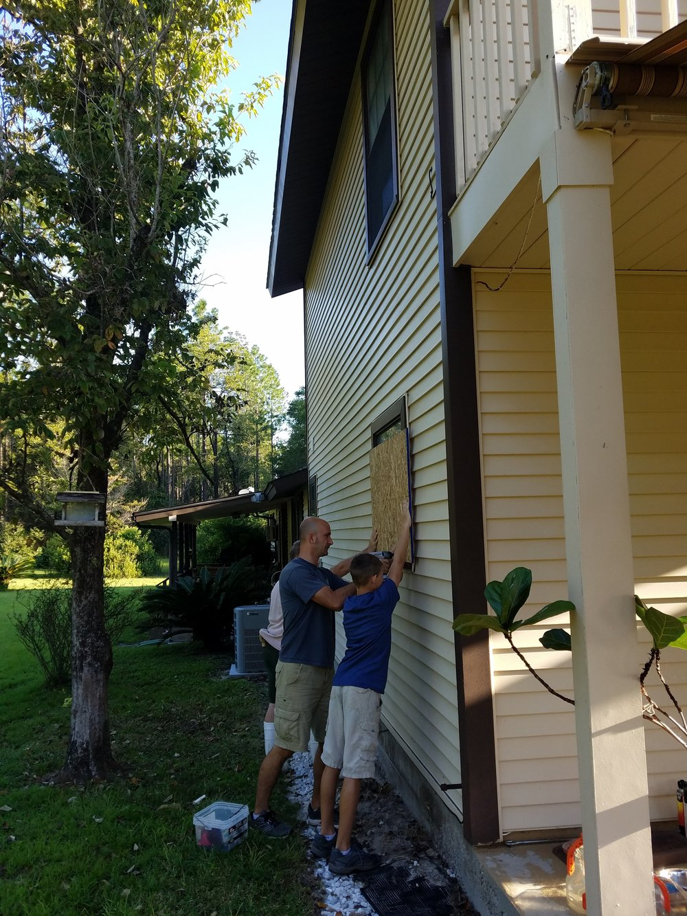 Hard workin boys, boarding up Ms Pat's home!