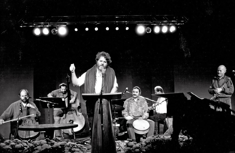Paul Winter Consort in performance at the 1992 Geraldine R. Dodge Poetry Festival with Rumi Poet Colman Barks. L to R Eugene Friesen, Eliot Wadopian, Coleman Barks, Glen Velez, Paul Halley, Paul Winter.  Photo by Bill Abranowicz
