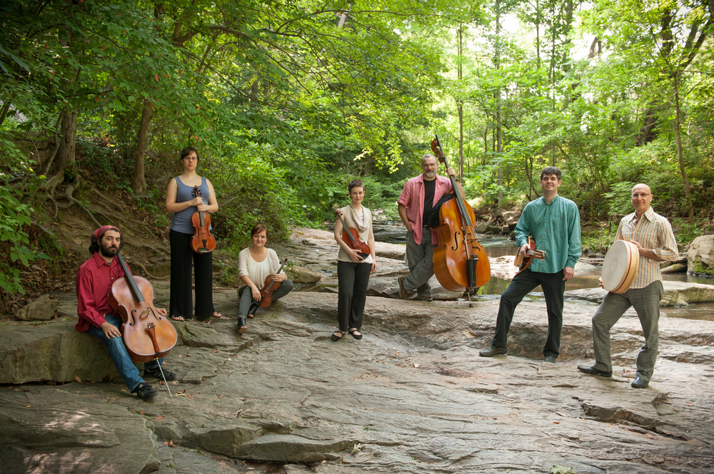 Free Planet Radio with the Opal String Quartet. L to R: Franklin Keel-cello, Kara Poorbaugh-viola, Mariya Potapova-violin, Ginger Kowal-violin, Eliot Wadopian-bass, Chris Rosser-oud, River Guerguerian-frame drum