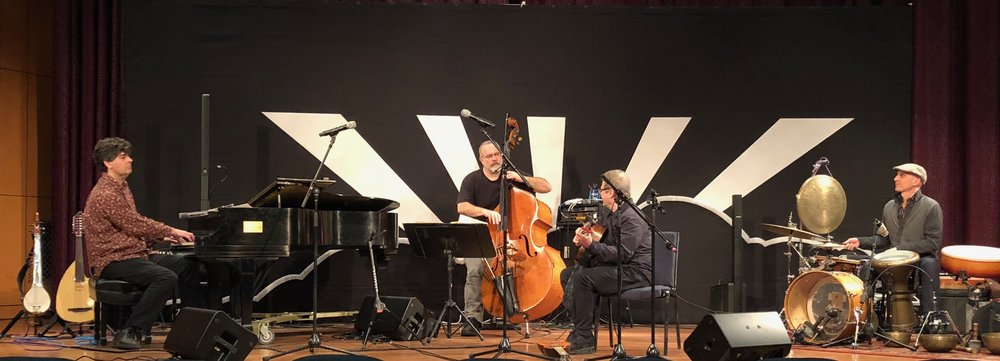 Rehearsal Gladdening Light Symposium 2018. Chris Rosser-piano, Eliot Wadopian-bass, Gustavo Santaolalla-guitar, River Guerguerian-percussion.