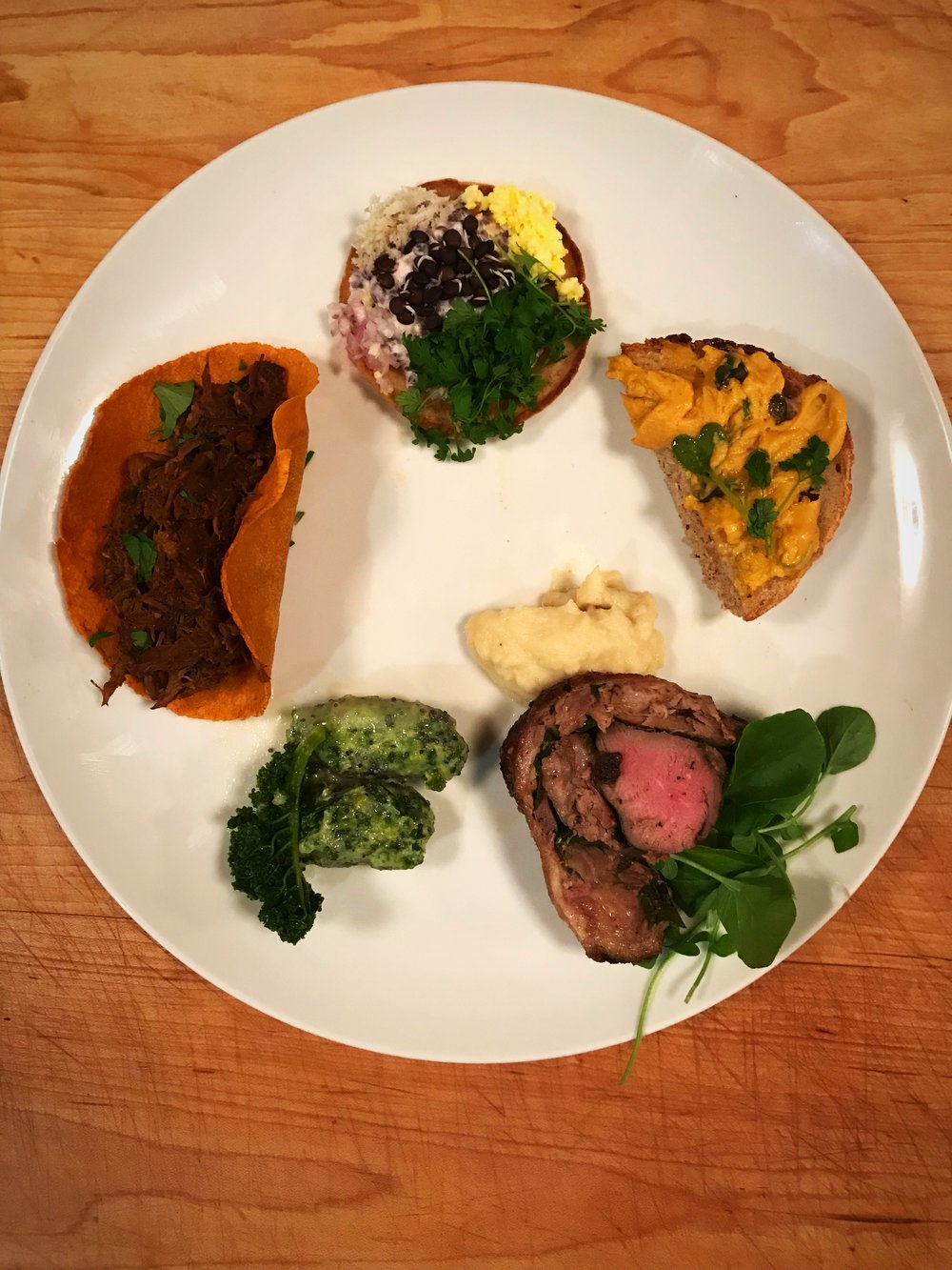 Each of the First Five Course from the January Farm to Table Dinner: Carrot Butter on Sourdough; Rye Blini with Sprouted Lentils; Venison Barbacoa; Kale Malfatti; and Duck Roulade