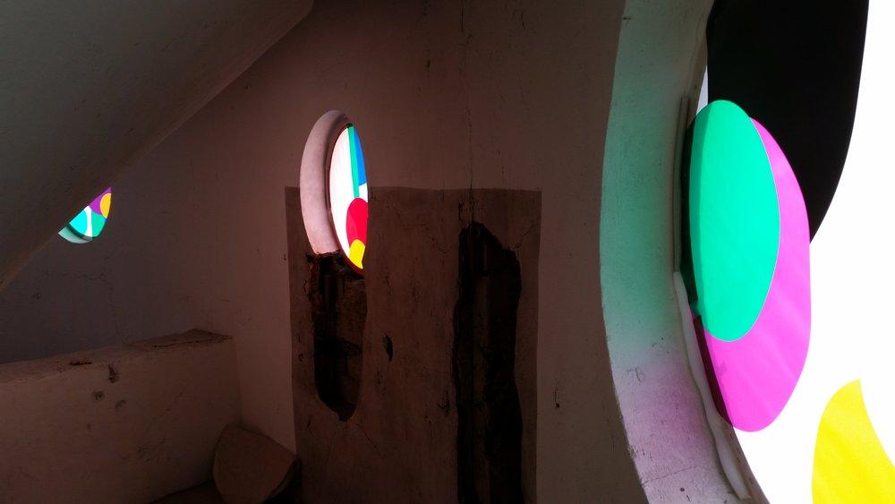 Interior view of three round windows.