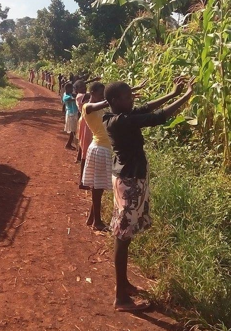 2015 - The girls praying over the new land, asking God to provide for the construction of their new home.