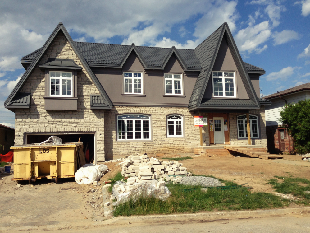 Stucco and roof are complete - stone was added to the second storey blending the old and the new