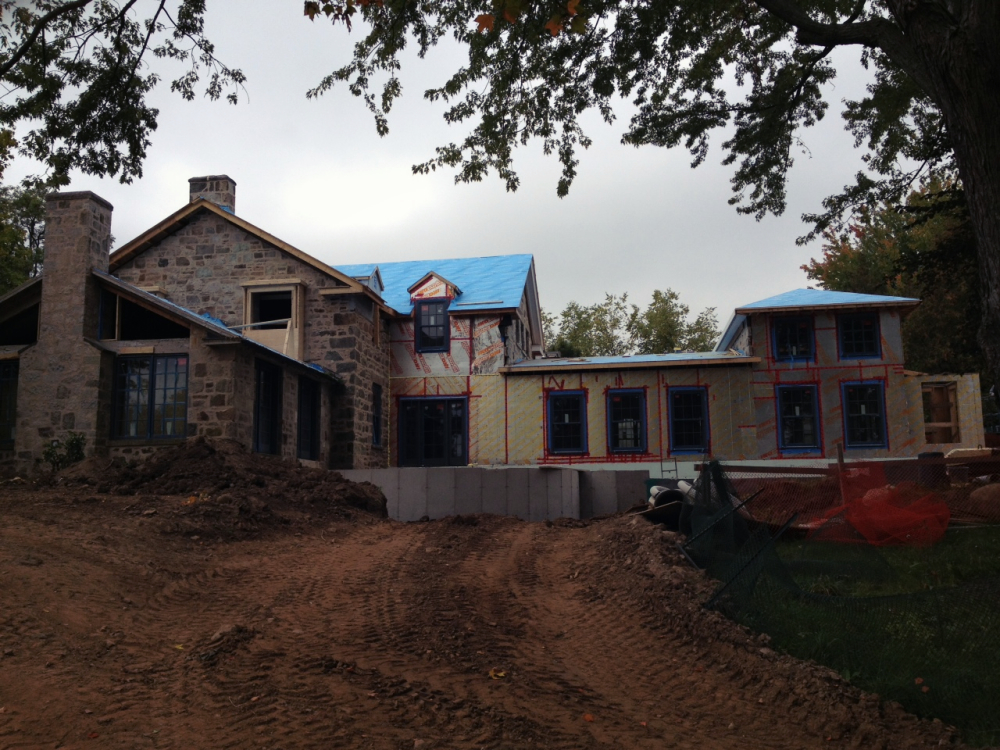 Rear addition is framed and windows are installed