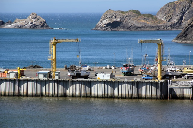 "The ""dolly dock"" at the Port of Port Orford is the only one in America and one of just a few in the world. Because the port is directly on the ocean, without a safe harbor, cranes lift boats in and out of the water. Boats park in homemade moveable ""dollies."" The cost of upkeep is a challenge that regional seafood ""value chain"" development aims to help solve with new revenue from stronger commercial fishing businesses. CREDIT: Courtesy of Port Orford Sustainable Seafood"