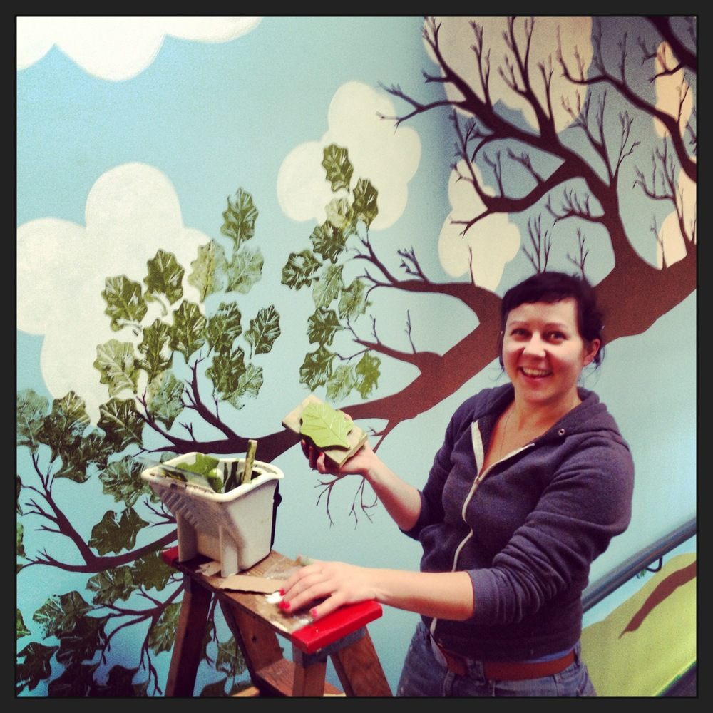 Renée Sala, Director of Crafty School of Art, hand-printing leaves onto a large-scale mural project at Oaklands Elementary School, 2014.