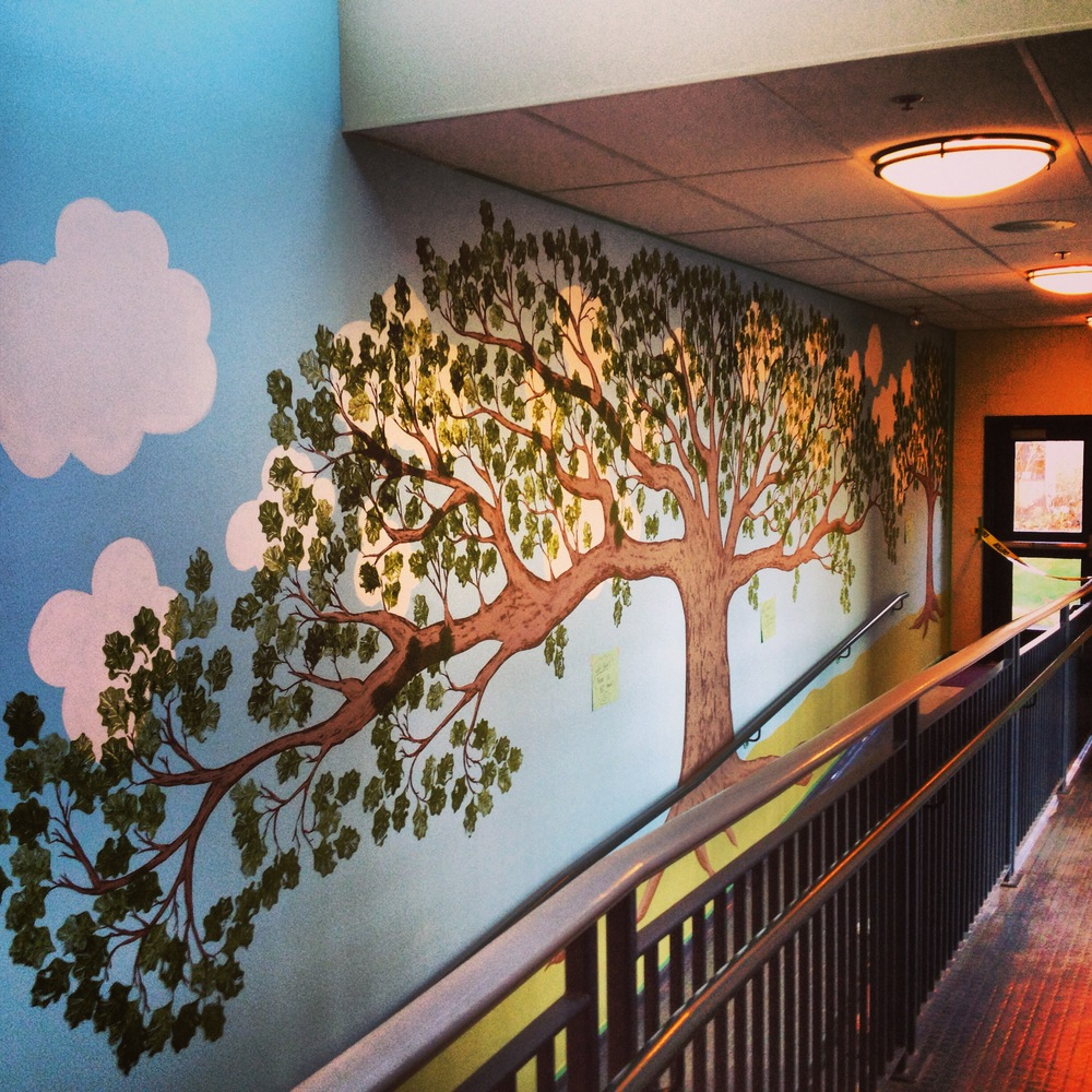 Renée Sala painted this beautiful Oak Tree in a long empty hallway of Oaklands Elementary School to celebrate their Centennial.  All of the students created clay tiles with her, and then Renée adorned the leaves with the children's work to create a fabulous collaboration.