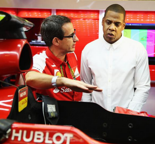 aintnojigga :     Jay Z being shown around the  Ferrari  race team garage on Friday, ahead of the  Abu Dhabi Formula One Grand Prix  in the United Arab Emirates.