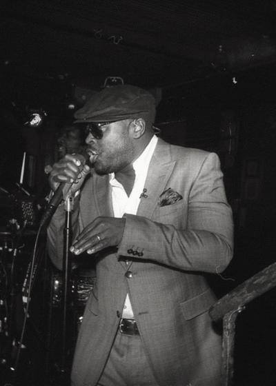 "October 3rd – Black Thought of The Roots was born Tariq Trotter in Philadelphia, Pennsylvania on this day in 1970. Black Thought met Ahmir Thompson, who would later be known to the world as Questlove, at The Philadelphia High School For Performing Arts. It was there that they formed a duo called The Square Roots and would perform as a duo with Thompson drumming and Black Thought rapping. Eventually, MC Malik B. join the group when Thought met him at Millersville University. The Roots would in 1993 add bassist Josh Abrams to the group, who the following year would be replaced by Leonard Hubbard and future superstar producer Scott Storch on keyboards, who would soon be replaced by Kamal Gray. Over the years, The Roots have had two more bass players, Owen Biddle and Mark Kelley, guitarist Ben Kenney and Captain Kirk Douglas, percussionist Frankie Knuckles, sousaphonist Damon ""Tuba Gooding Jr."" Bryson as well as beatboxers Rahzel and Scratch. The Roots, who are the current in-house band for NBC's ""Late Night With Jimmy Fallon"" also include longtime collaborator James Poyser on keyboards for the show. You can check out the roots digital bio right here: http://hiphopsmithsonian.com/the-roots/"