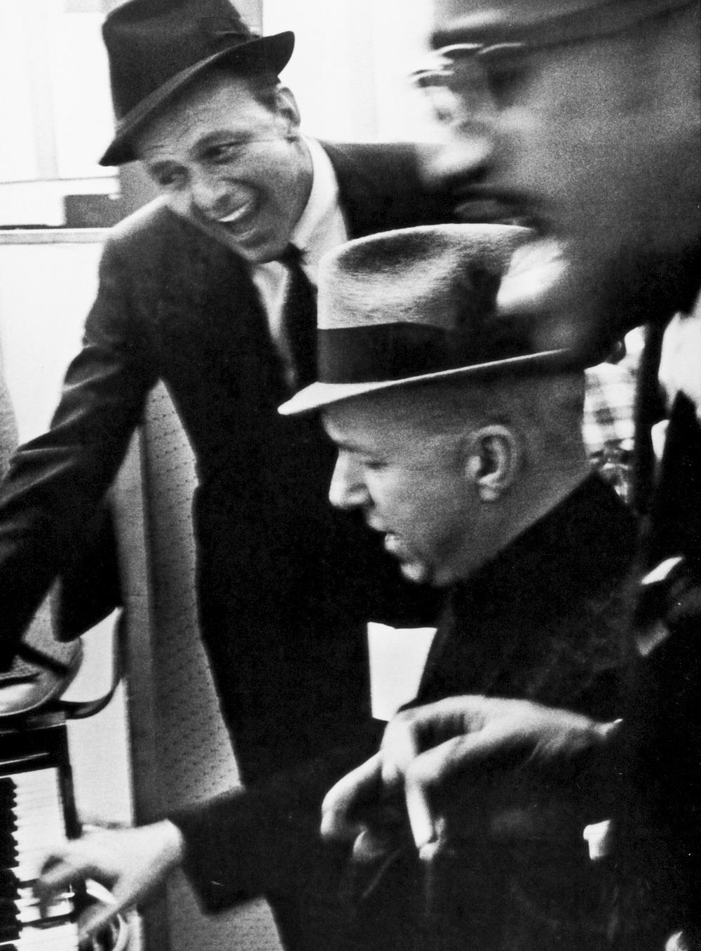 Frank Sinatra, Jimmy Van Heusen and Sammy Davis Jr. photographed by Phil Stern, ca. 1955.