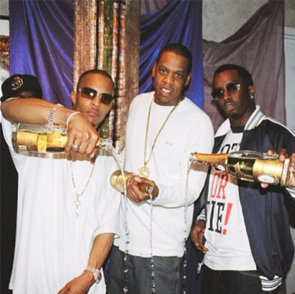 """aintnojigga: """"I used to drink Cristal, them fucker's racist"""" Jay-Z, T.I., and Diddy pouring out bottles of Cristal after it was given to them backstage on the Heart of the City Tour in 2008."""