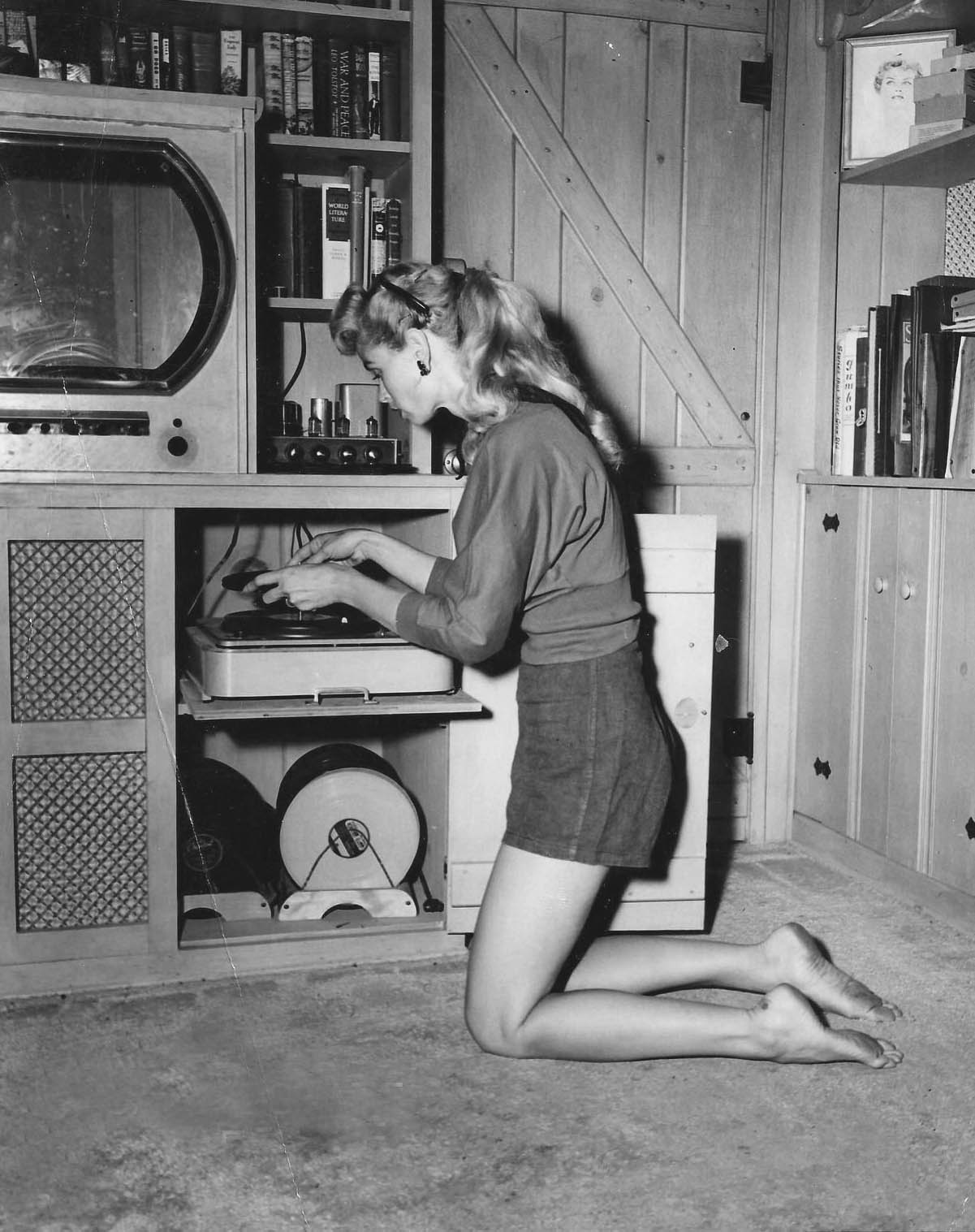 retrogirly :     Irish McCalla listens to records.