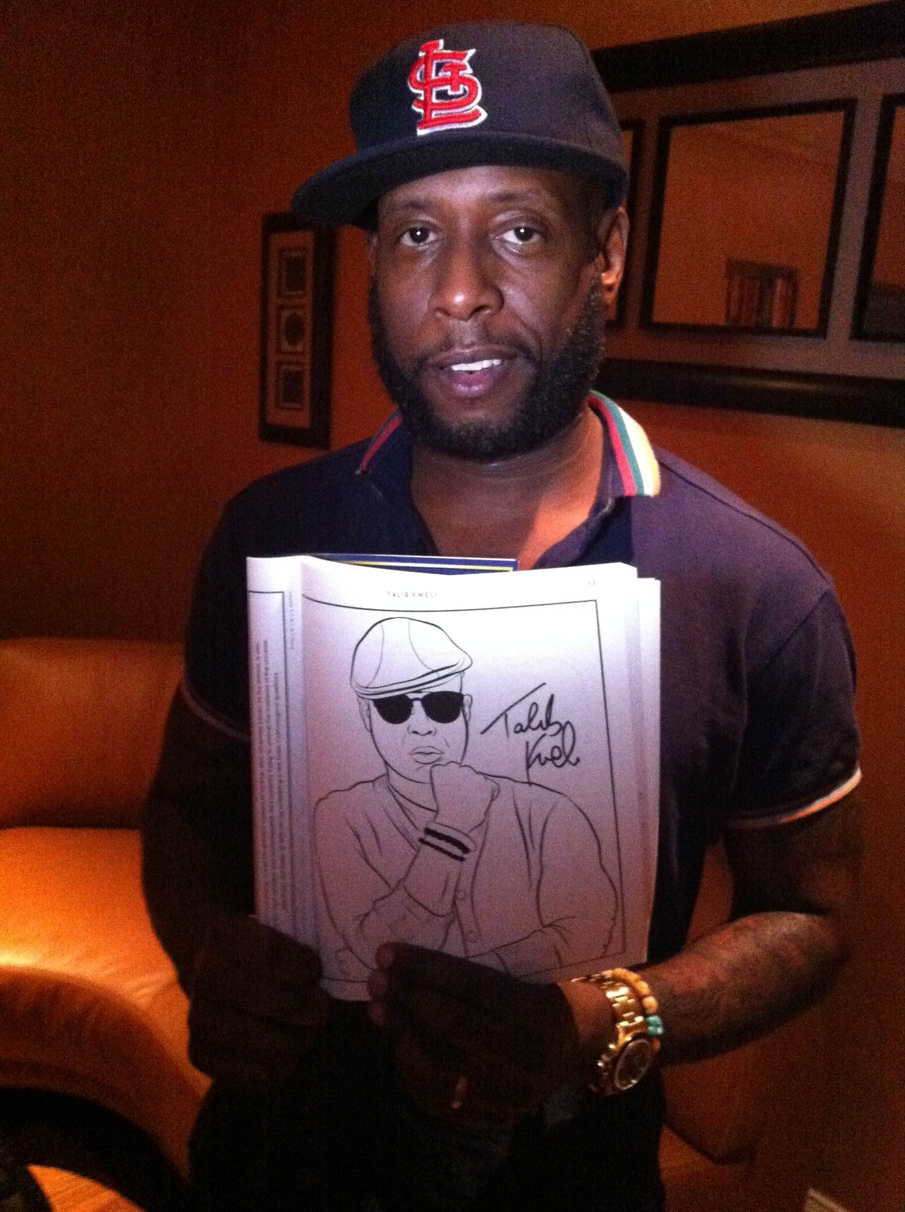 rapcoloringbook: I mean, come on. That's the glorious Talib Kweli posing with his page in the rap coloring book. So incredible. Thanks to Revolt TV'sSamaan Ashrawi for sending this in and thanks to you all for being amazing and wonderful humans. I hope good things happen to you guys for the whole rest of the week. You're so true and real. Bun B's Rap Coloring and Activity Bookis in stores now.Please go buy one. You totally deserve to have it. Rap Coloring Book onTwitter http://hiphopsmithsonian.com/talib-kweli/