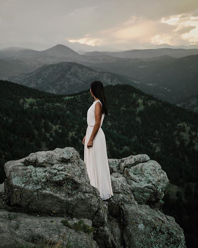 @kmccormi, staring down her next 14-er in a white dress and hiking boots.