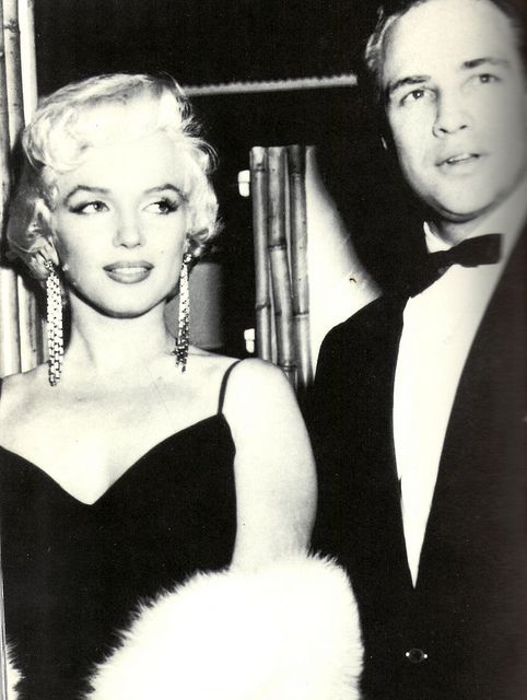 At the Oscars with Marilyn (before he went nuts and refused to go to the Oscars anymore)... I wonder if they ever hooked up...
