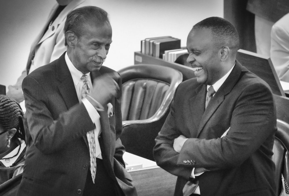 Rep. Mickey Michaux (left) and Rep. Robert Reives in a lighter moment following the House vote that passed HB 927.