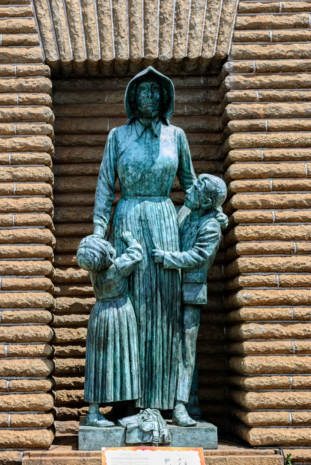 Voortrekker woman and children by Anton van Wouw.