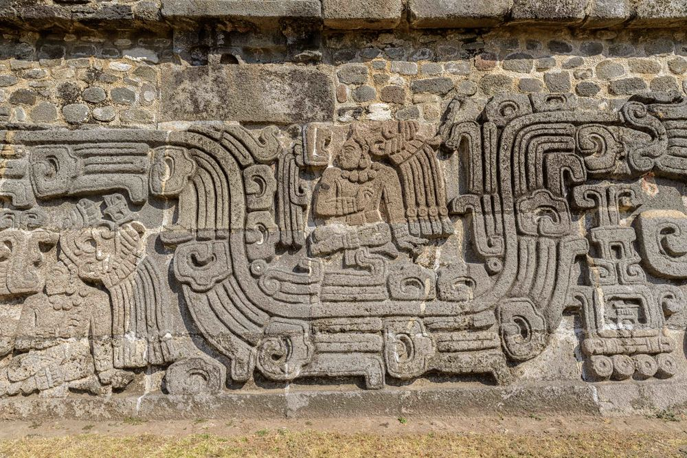 The Temple of the Feathered Serpent at Xochicalco has fine stylized depictions of that deity in a style which includes apparent influences of Teotihuacan and Maya art.