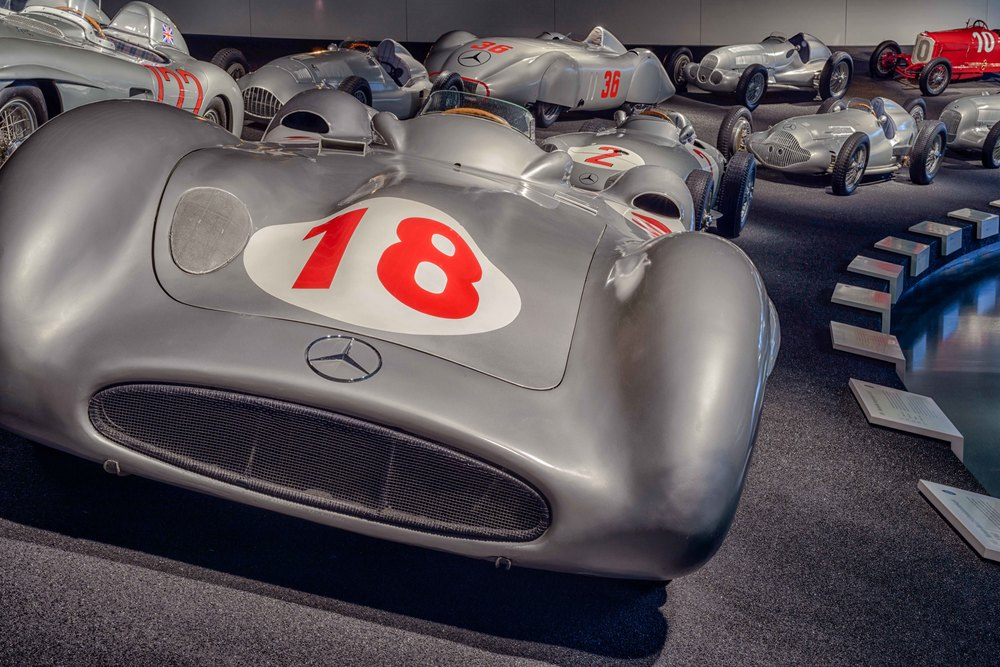 Mercedes-Benz W 196 R 2.5-liter streamlined racing car.   Mercedes-Benz made its return to Grand Prix racing with the streamlined W 196 R. Juan Manuel Fangio and Karl Kling powered to a 1-2 victory in the new Formula One car's first race on July 4, 1954 in Reims, and Fangio finished the season as world champion. The Argentinean piloted an improved version of the streamlined car to victory in the 1955 Italian Grand Prix and went on to retain the world title.
