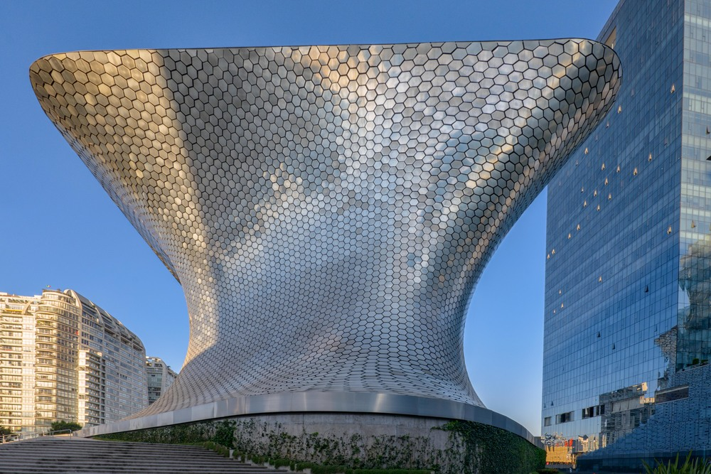 The building is a 46-metre (151 ft) high six story building that is covered by 16,000 hexagonal aluminum tiles.