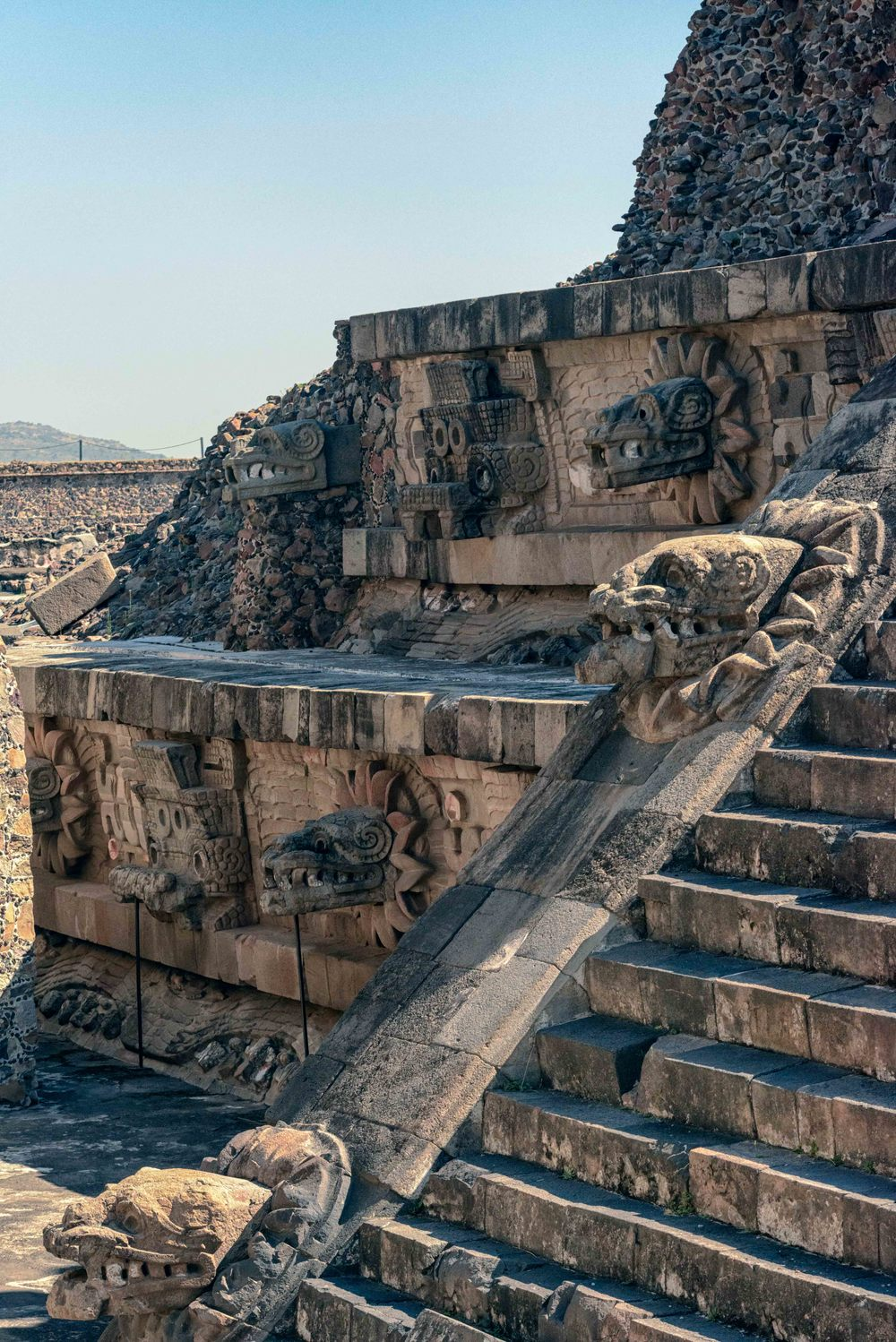 The left side of the Pyramid of the Feathered Serpent, from the steps of the Adosada platform.