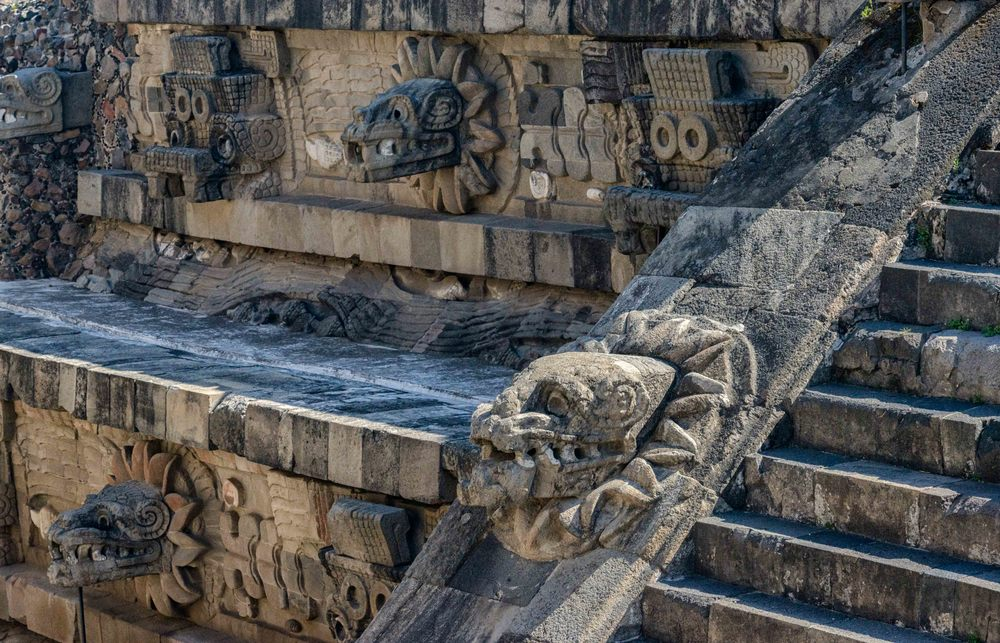 Details of the left side of the Pyramid of the Feathered Serpent, from the steps of the Adosada platform.