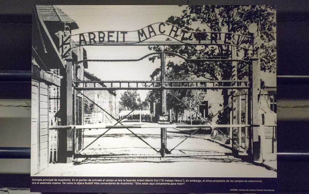 "Main entrance to Auschwitz. At the gate entrance to the camp the legend caption stands ""Arbeit macht frei"" (""Work makes you free"")."