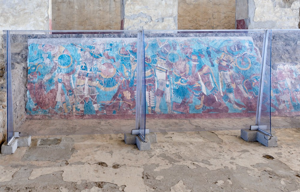 "The most famous of Cacaxtla's preserved paintings is the ""Battle Mural"", or Mural de la batalla, located in the northern plaza of the basamento. It is placed on the sloping limestone wall of a temple base and is split in two by a central staircase."