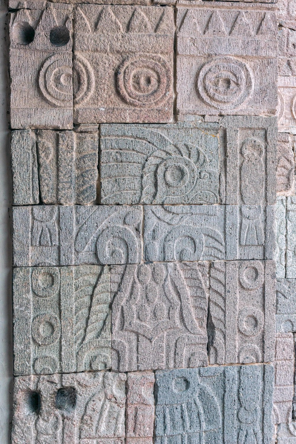 "The stone column shows a quetzal.   More recently the excavator and others have realized that the creature was none other than the ubiquitous Teotihuacan Armed Bird. Also called, ""Spearthrower Owl."""