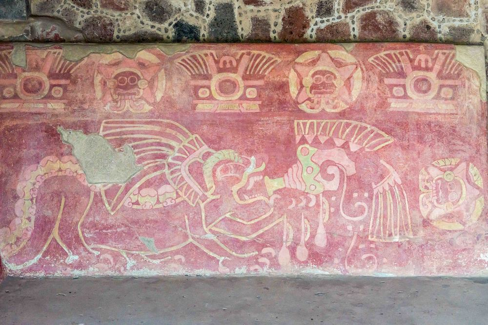 Tlaloc, the rain god, peers down on the trumpet-blowing jaguar. This representation of Tlaloc is repeated several times along the top of the mural. Tlaloc is everywhere, from the great Pyramid of the Sun to rooms in private homes at Teotihuacan.