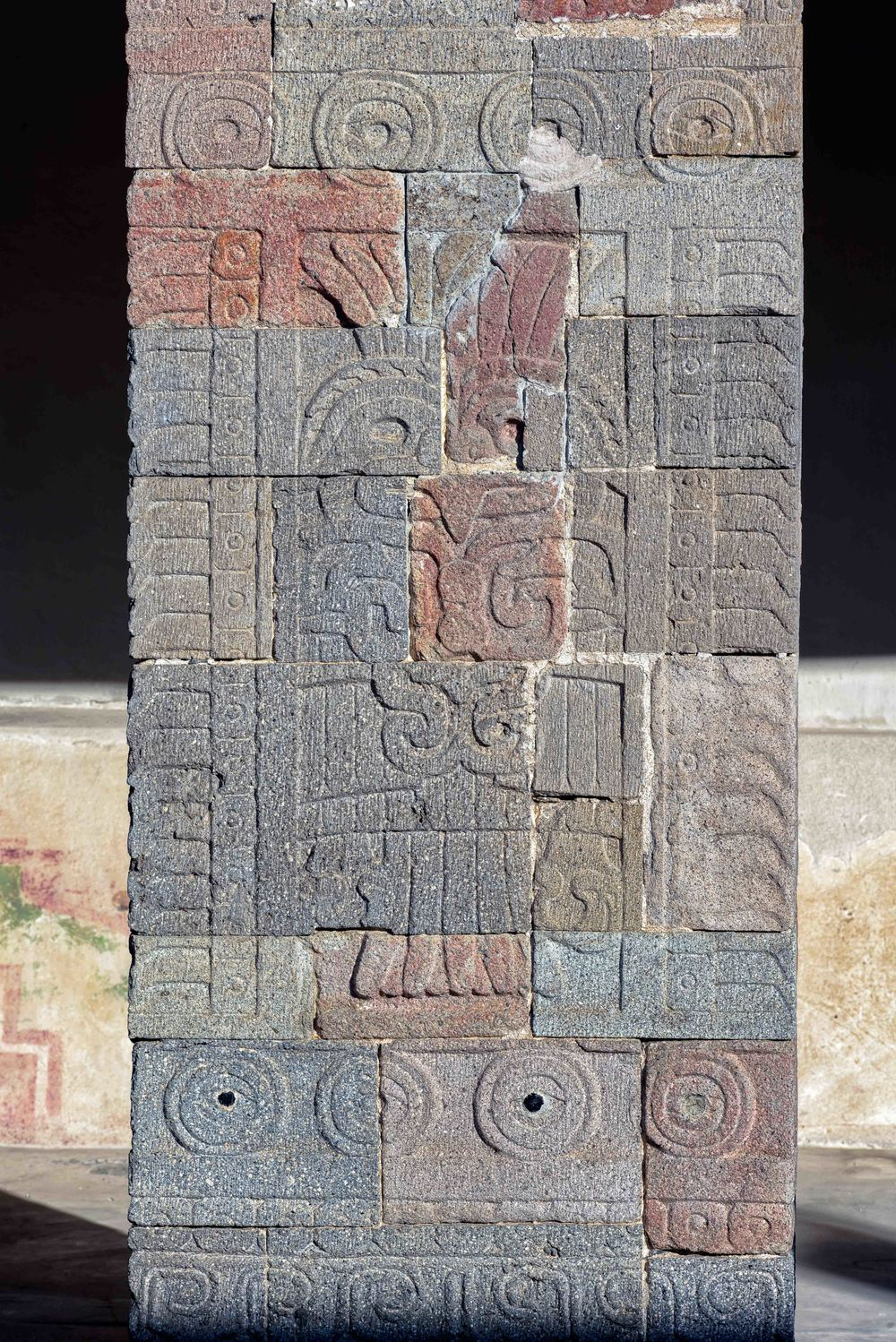 The stone columns are profusely carved with representations of quetzals ad owls, where painted and had obsidian incrustations. Here an owl is shown.