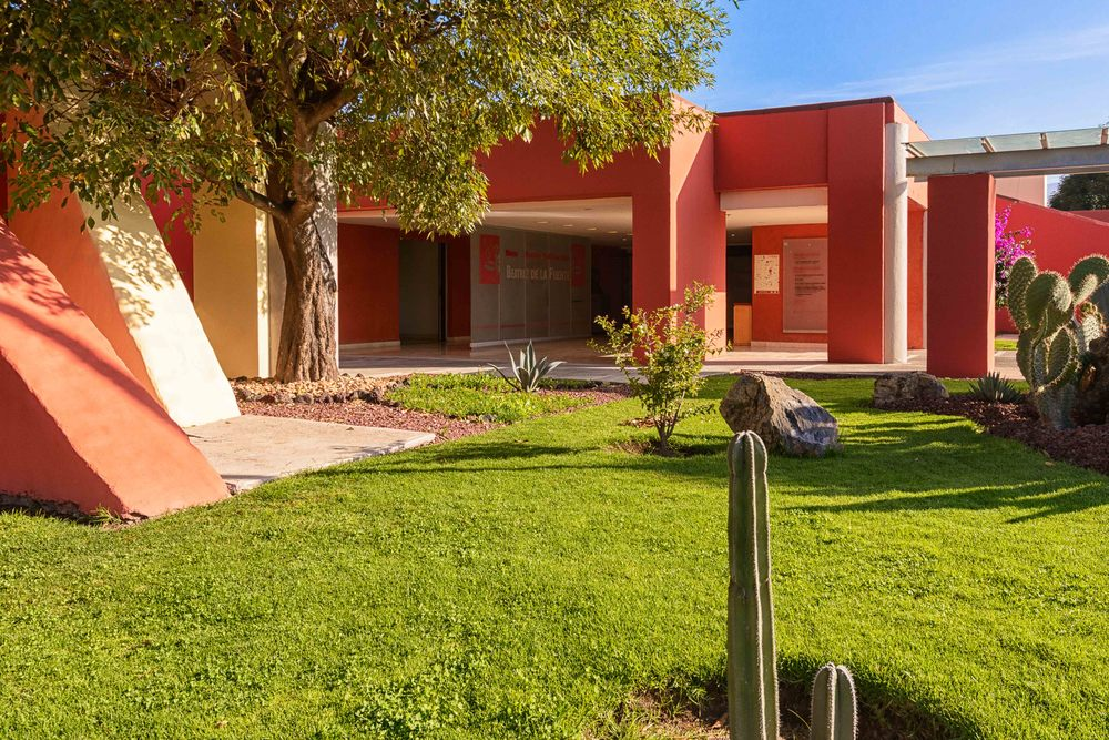 "Entrance to the ""Beatriz de la Fuente"" museum with the murals of Teotihuacan.  Over more than a century of archaeological excavations recovered in the area are shown."