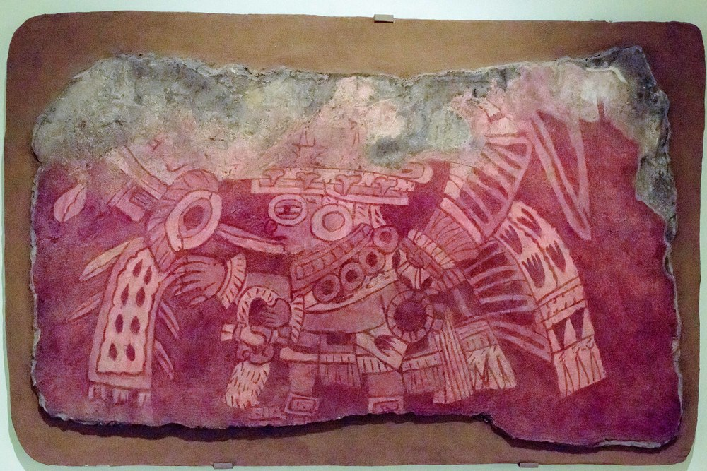 Priest Impersonating Tlaloc. This fragment shows us a priest. Wearing the goggles characteristic of a god who the Mexicas (Aztecs) called Tlaloc. Because we don't know the Teotihuacan name of this god, we use the Mexica name due to how similar the deities appear in the two great Mesoamerican cultures.