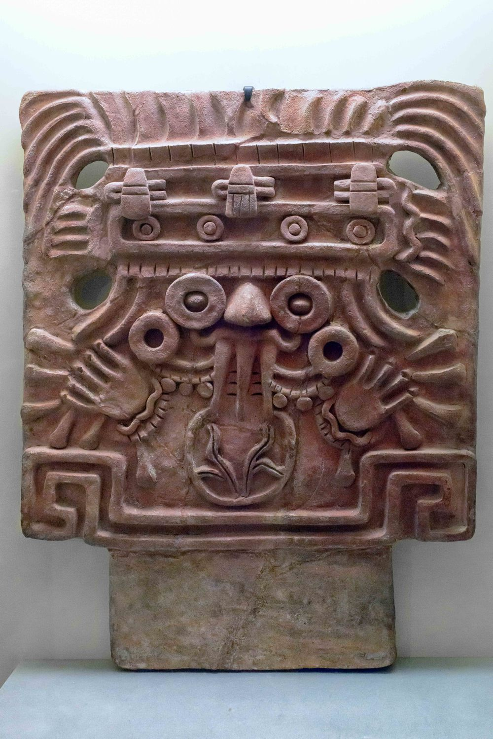 Merlon with Tlaloc Face. The god of rain and of time, Tlaloc is associated with the sun through his symbols, such as the trapezoid-and-ray headdress. Another such symbol is the nymphaea flower, commonly (and incorrectly) called water lily, in the mouth of the deity.