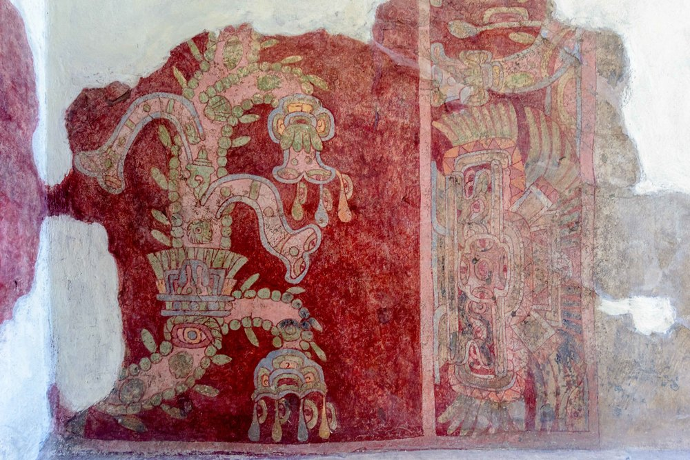 In years leading up to 1942, a series of murals   were found in the Tepantitla   compound in Teotihuacan. The Tepantitla compound provided housing for what appears to have been high status citizens and its walls (as well as much of Teotihuacan) are adorned with brightly painted frescoes. The largest figures within the murals depicted complex and ornate deities or supernaturals.