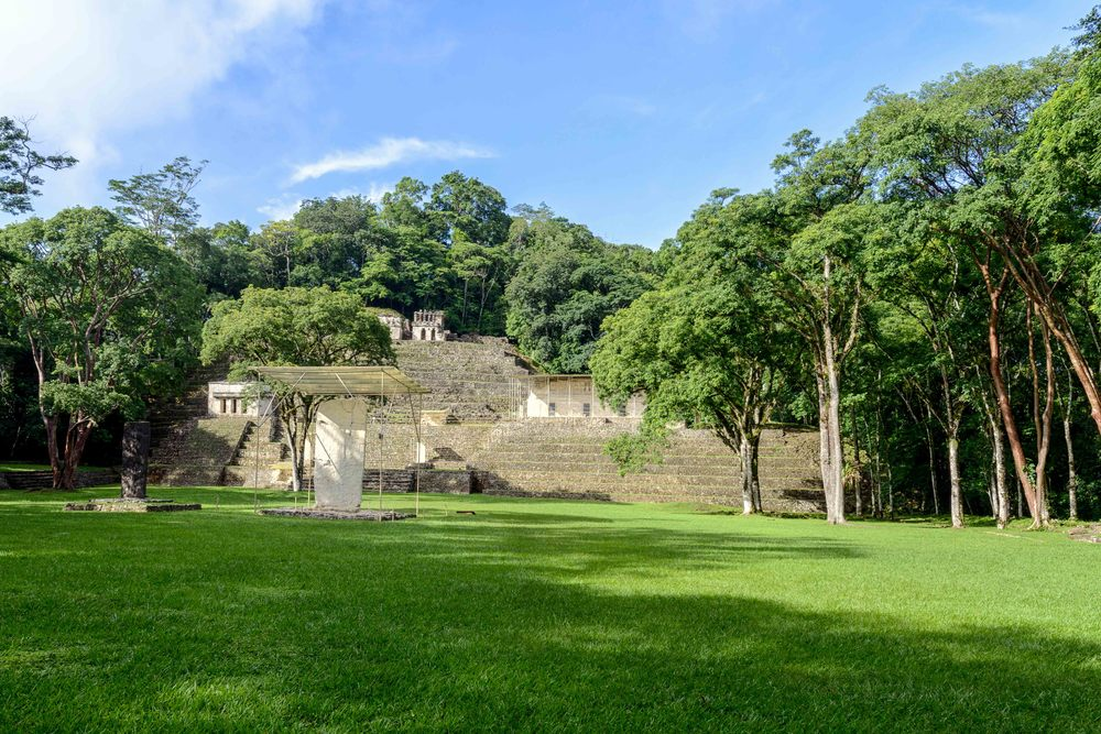 Bonampak's Great Plaza is one of the most spacious in the region, measuring 90 by 110 yards. Its location as the approach to the Acropolis provides the combined whole with a sense of monumentality.