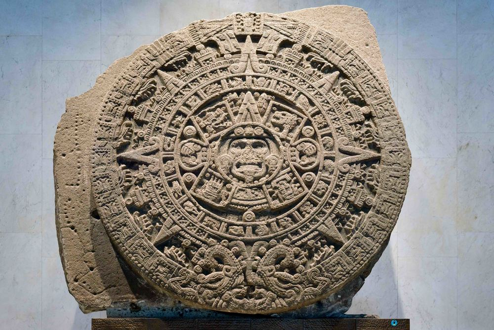 The Aztec  Calendar Stone ,  Sun Stone ,  Piedra del Sol , or  Stone of the Five Eras  is a late Post-Classic Mexica sculpture, and is perhaps the most famous work of Aztec sculpture. The stone is 358 centimetres (11.75 ft) in diameter and 98 centimetres (3.22 ft) thick, and it weighs about 24 tons.